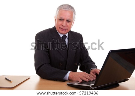mature businessman  working at computer, isolated on white background. Studio shot. - stock photo