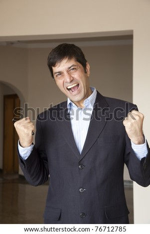 mature businessman yelling and screaming in anger - stock photo