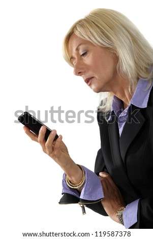 mature businesswoman holding a cell - stock photo
