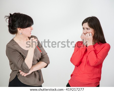 Mature businesswoman speaking with her subordinate, neutral background