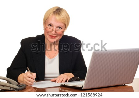 Mature businesswoman writes and looks at you with smile. Isolated against white background.