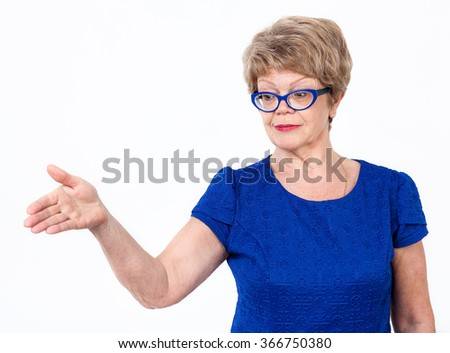 Mature Caucasian woman gesturing with arm to copy space, white background - stock photo