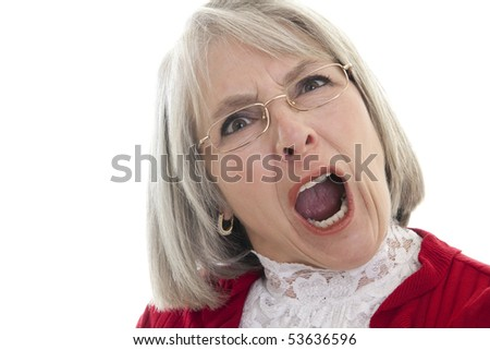 Mature Caucasian woman yelling with an angry expression