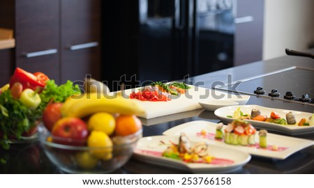 mature chef preparing a meal with various fruits and vegetables