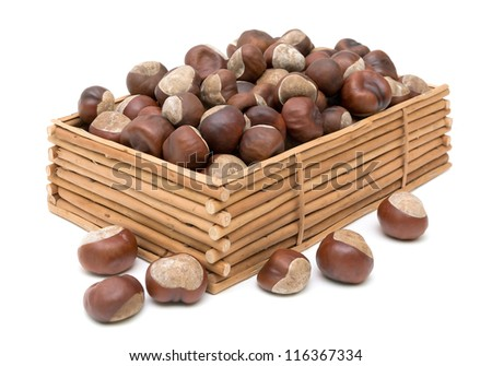 mature chestnuts in a wooden box isolated on white background - stock photo