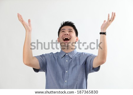 Mature chinese man with surprise expression