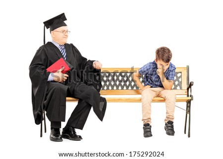 Mature college professor and a thoughtful kid seated on bench isolated on white background - stock photo