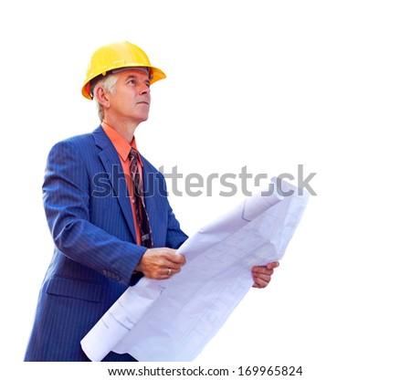 Mature construction foreman looking up while holding blueprint. Horizontal shot. - stock photo