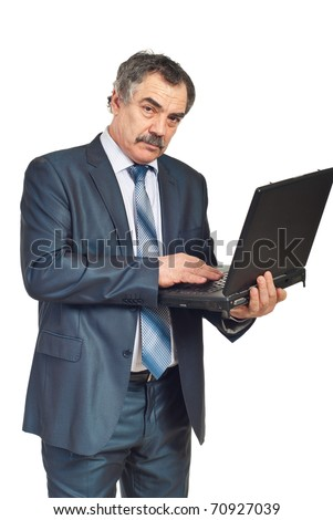 Mature corporate man with mustache working on laptop isolated on white background