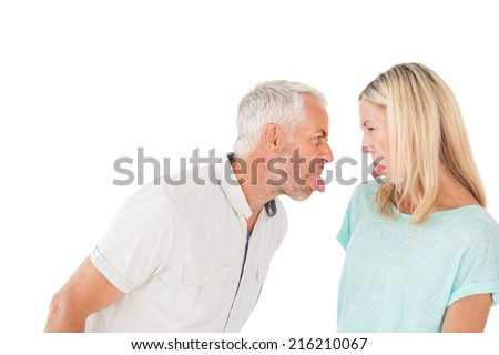 Mature couple arguing with each other over white background