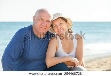 mature couple at sea vacation - stock photo