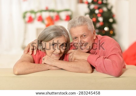 Mature couple celebrating new year at home - stock photo