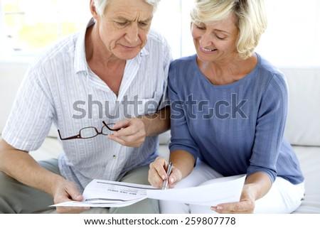 Mature couple doing Home Finance - stock photo