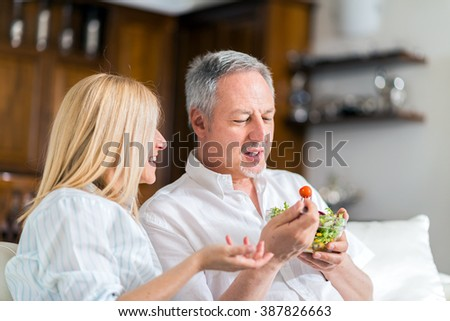Mature couple eating a healthy salad