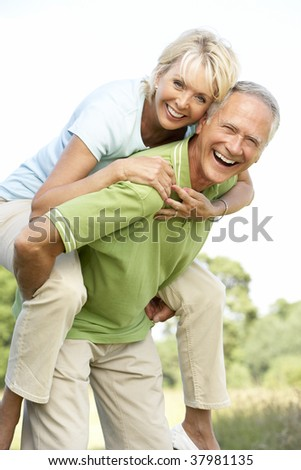 Mature couple having fun in countryside - stock photo