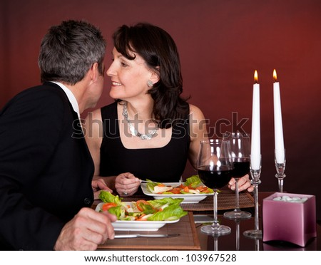 Mature couple having romantic dinner in restaurant - stock photo
