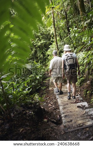 Mature Couple Hiking in Wilderness Area - stock photo