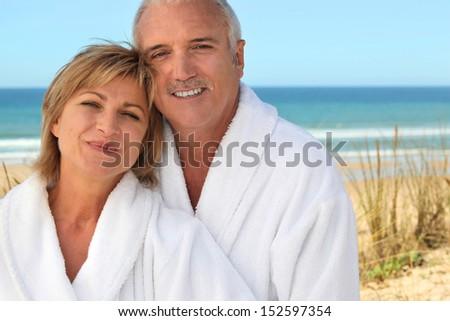 Mature couple in bathrobe - stock photo
