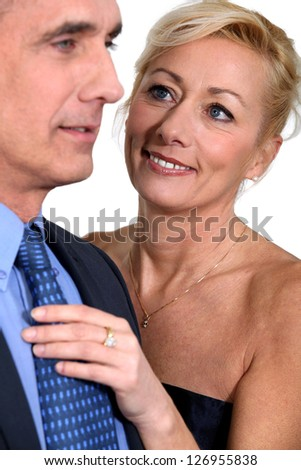 Mature couple in evening dress - stock photo