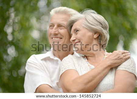 Mature couple in love walking in the park in spring - stock photo