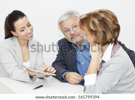 Mature Couple in Meeting With Financial Advisor. - stock photo