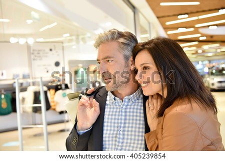 Mature couple in shopping center
