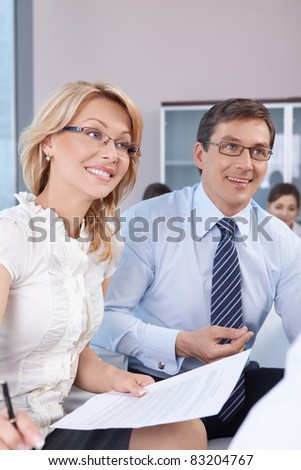 Mature couple in the office - stock photo