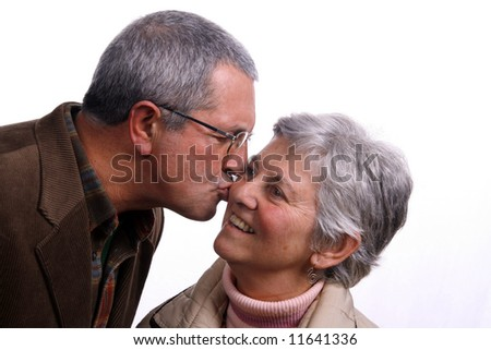 mature couple kissing over white background - stock photo