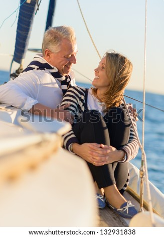 Mature Couple Looking At Each Other, Outdoors - stock photo