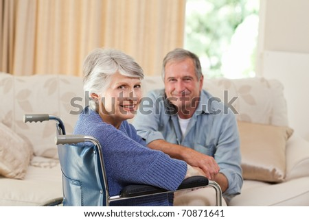 Mature couple looking at the camera - stock photo