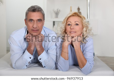 mature couple lying on the bed