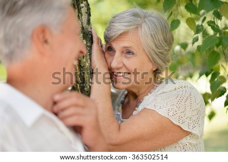 mature couple on a walk in the park