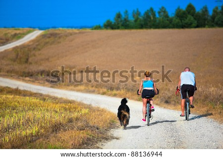 Mature couple on bike. Sport, active lifestyle - stock photo