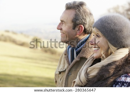 Mature couple on country walk in winter