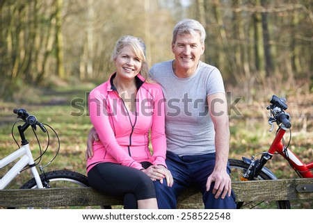 Mature Couple On Cycle Ride In Countryside Together - stock photo