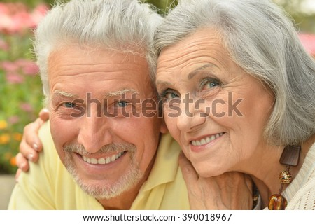 mature couple on  in summer park