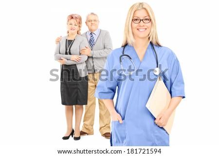 Mature couple posing behind female doctor isolated on white background - stock photo