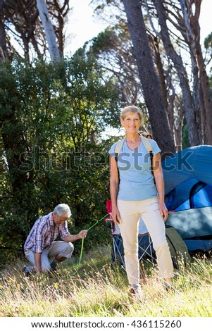 Mature couple preparing hike on camp site