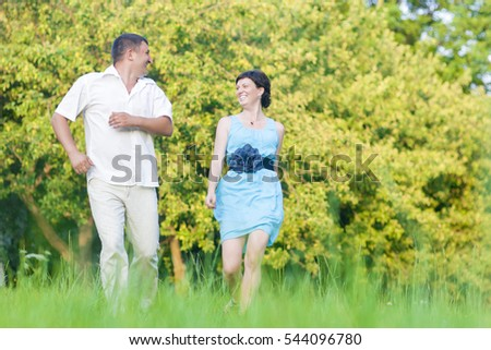 Mature Couple Relationships Concepts and Ideas.Happy caucasian Couple Having Good Time Outdoors Walking Together. Horizontal Image Orientation