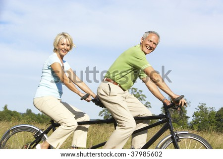 Mature couple riding tandem