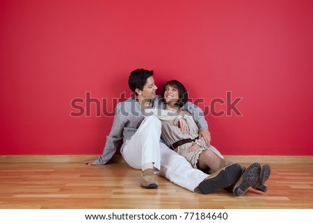 mature couple sited in the floor of his new house - stock photo