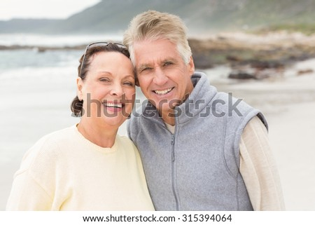 Mature couple spending time together at the beach - stock photo