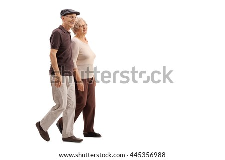 Mature couple walking together and smiling isolated on white background - stock photo