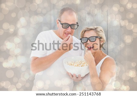 Mature couple wearing 3d glasses eating popcorn against light glowing dots design pattern - stock photo