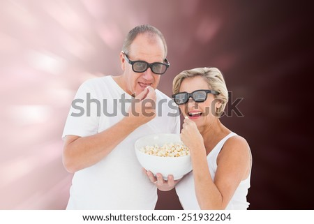 Mature couple wearing 3d glasses eating popcorn against valentines heart design - stock photo