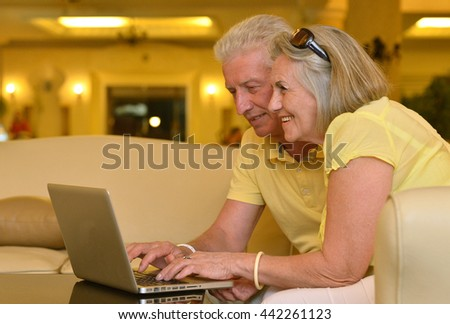 Mature couple with laptop
