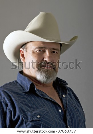 Mature cowboy ready to work on fences all day