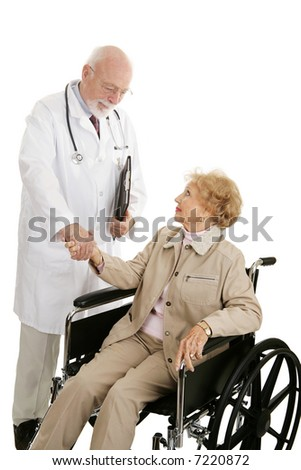 Mature doctor congratulates his disabled patient on a successful treatment.  Isolated on white. - stock photo