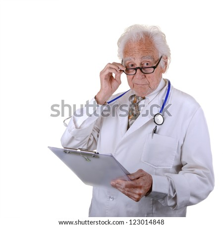 Mature doctor holding a chart wearing glasses with a serious look on face isolated on white - stock photo