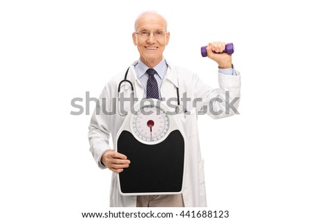 Mature doctor holding a weight scale and a dumbbell isolated on white background